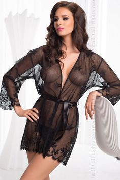 Seductive black dressing gown from the Diamond range by Irall, made in a soft semi transparent fabric. Decorated beautifully around cuffs and hemline. Comes with satin belt around waist.