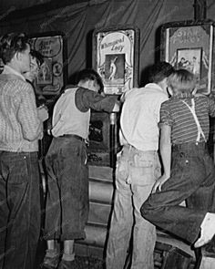 """Boys swarm around peep-shows in a penny arcade at an outdoor carnival in Granville, West Virginia, September, 1938 - [[MORE]] namraka: Original caption: """"It's a dirty jip,"""" say the mine workers' sons. Shorpy Historical Photos, Historical Quotes, Old Pictures, Old Photos, Vintage Photos, Vintage Stuff, West Virginia History, Penny Arcade, Peep Show"""