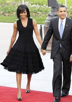 2009 - AZZEDINE ALAIA Mrs. Obama joined her husband on the red carpet for a NATO event in Baden-Baden, Germany, looking sleek and sophisticated in an Azzedine Alaia LBD.