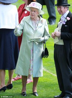 Checking the form: The Queen talks horses with racing manager John Warren...