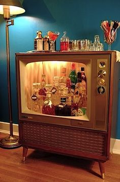 Old television reused as a bar cart. Super fun idea!!!