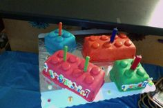 Lego blocks cake. After making the cakes each one was covered with marshmallow fondant and the little circles on top were cut out of the fondant too.