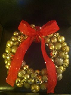 DIY Wreath. I bought the ornaments & ribbon at Dollar Tree.