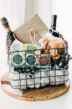 the ultimate cheese gift basket – playswellwithbutter a cheese board gift basket that's as stunning as it is delicious is so simple to pull together with a few hacks via playswellwithbutter Kitchen Gift Baskets, Cheese Gift Baskets, Cheese Gifts, Food Gift Baskets, Themed Gift Baskets, Wine Baskets, Gifts For Cheese Lovers, Wine Basket Gift, Picnic Gift Basket