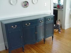 paint my mid-century sideboard in f hague blue (photo in oil based high gloss) or sw urbane bronze.