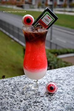 Drunk Zombie Eyes Cocktail - For more delicious recipes and drinks, visit us here: www.tipsybartender.com