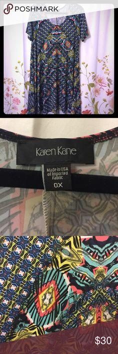 Karen Kane Multicolor Dress This women's size 0X Karen Kane dress is so cute and trendy! Multicolor design, midi length, short sleeves. Perfect wardrobe addition for spring/summer. NWOT, never worn, perfect condition. Karen Kane Dresses Midi