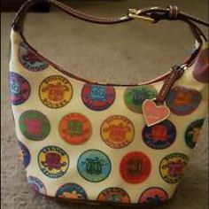 """💖RARE💖 Dooney & Bourke Medallion Bucket 💖 💖Authentic Dooney & Bourke Medallion Bucket Handbag💖 • RARE and DISCONTINUED cream color with multicolored DB logo medallions  • Uncut DB Authenticity Tag with serial numbers  • Excellent used condition • Non smoking home/ depth is 5.5"""" and length 8"""". Dooney & Bourke Bags Shoulder Bags"""