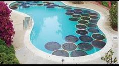 """Pinner says - DIY Hula Hoop Pool Warmers If you'd like to save a bit on your heating bills, these black, sun-catching """"lily pads"""" will help absorb some heat and insulate your pool, so you can keep swimming even when it's a bit cooler outside."""