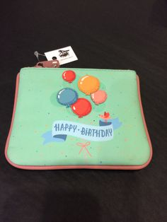 Fab little leather coin purse, with birthday balloons on the front. £11 www.mymagpiesnest.com