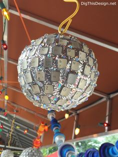 Satchel's upcycled keyboard keys into disco ball junk art in Gainesville, Florida