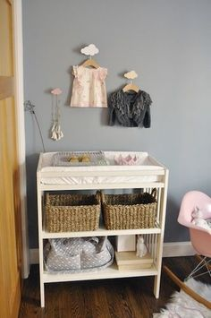 Baby girl frocks above the changing table -- love!