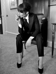 MENSWEAR FOR WOMEN  Noomi Rapace wear's A.Sauvage  autumn/winter 2012  black W1 Tuxedo Suit  black afro prep tie  classic collar shirt  photo: adrien sauvage