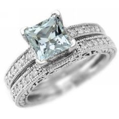 princess cut aquamarine...like the champagne pink one better but this is beautiful.