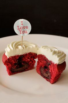 Red Velvet Surprise Cupcakes for Valentine's Day.. the surprise is a Lindt ball hidden inside each cupcake!