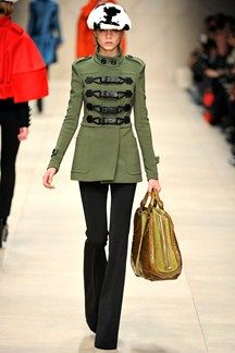 Burberry Prorsum Autumn/Winter 2011-12. Military inspired trench coat with interesting closures at the front.