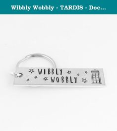 "Wibbly Wobbly - TARDIS - Doctor Who - Aluminum Key Chain. This Doctor Who inspired ""Wibbly Wobbly"" aluminum keychain is hand stamped with care, one letter at a time. Stamped on the end of the keychain is every Whovians favorite time travel device, the Tardis. This key chain is stamped on a 1/2"" x 2"" aluminum blank. Please note that due to the nature of hand stamping, every item varies slightly from the photo."