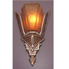 Wonderful 1920s - 1930s Art Deco slip shade wall sconces refinished as they were when new, with highly polished aluminum frame sections and a warm antique golden color between the polished aluminum.  One slip shade has a small chip on the right side at the top, hardly noticeable on the right sconce.  http://www.vintagelights.com/product/1/one-only-spectacular-vintage-art-deco-slip-shade-sconces.html