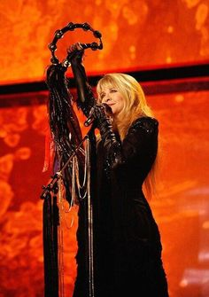 Stevie holding up her tambourine, in concert. ABSOLUTELY BEAUTIFUL !!!!!