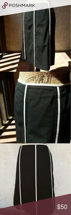 """Black w/white accent Ann Taylor skirt Black skirt with white trim, beautifully cut...hidden zipper on the side... the skirt is polyester/rayon/ spandex mix and the lining is 100% polyester... measures approximately 34"""" around the waist and approximately 23"""" from the waistband to hem....tu9... Ann Taylor Skirts"""