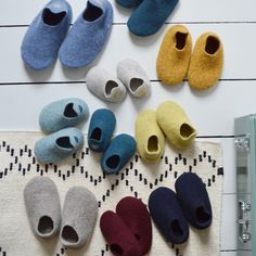 Hand made boiled merino wool slippers available at Camomile.london