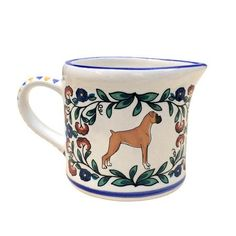 Boxer Dog Creamer This cheerful Boxer creamer is a wonderful addition to your home.  Useful for serving cream but also great for holding make-up brushes, a small bouquet of flowers, wrapped candies, p