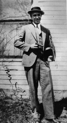 Public Enemy Number One - John Dillinger,  Crown Point, Indiana in 1934 - Dillinger's Dupes - Town Seeks to Preserve a Jail - Yet Escape a Dastardly Deed - Dillinger poses with a toy gun.