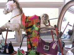 Interesting and unusual props for our instore displays.. The vintage rocking horse makes a great scarf display