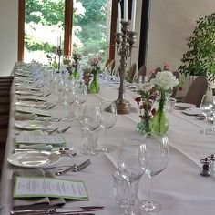 Theme is green and white, from the menu to the floral arrangement.