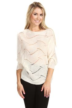The Sugarlips Heat Waves Sweater is a cream knit sweater with a dolman sleeve and a wavy printed pattern. Throw it on with a maxi skirt, ankle boots, and a floppy hat. #MyLuluCloset #Sugarlips #Storenvy #Sales #Tops