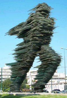 "Glass Sculpture - in Athens The statue called ""The Runner."" It is made of glass by the sculptor Costas Varotsos."