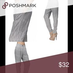 """Black and off white striped pants *Striped printed dress pants with front zipper closure and side pockets. *  Different sizes available S,M,L  Fabric: 100% Rayon  Model is wearing size ( S )  Size Chart   SIZE S ( 4-6 )  Bust: fits bust around 34-35"""" Waist: fits waist around 26-27"""" Hips: fits hips around 36-37""""  SIZE M ( 8-10 )  Bust: around 36-38"""" Waist: around 28-30"""" Hips: around 38-40""""  SIZE L ( 12-14 )  Bust: around 39-41"""" Waist: around 31-33"""" Hips: around 41-43"""" Thats So Trendy Pants"""