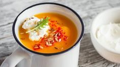 pumpkin soup served in an enamel mug with cream and paprika on a light wooden background Vegan Soup, Vegan Vegetarian, Pumpkin Soup, Russian Recipes, Cook At Home, Fun Cooking, C'est Bon, I Love Food, Food Styling