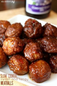 Slow Cooker Sweet and Tangy Meatballs on SixSistersStuff.com - perfect as a main dish or appetizer!