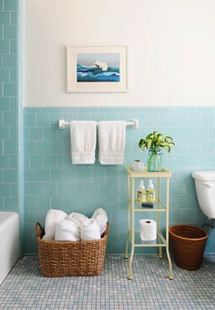 Pretty bathroom with aqua blue tiled half walls and bath surround.