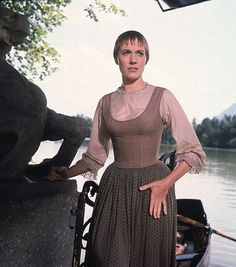"""""""The Sound Of Music"""" ~ Maria is about to be scolded by Captain Von Trapp after he discovers that she had taken his children on a sight-seeing trip around Salzburg, Austria.  Maria had been teaching them how to sing for the Baroness who was visiting from Vienna."""