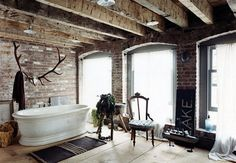 Rustic bathroom with a place for the husband's horns....AWESOME !!!