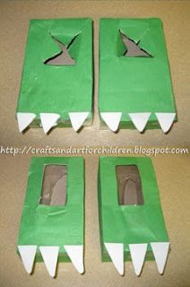 The dinosaur feet were made using Kleenex boxes for one set and oatmeal boxes for another set. I glued on green construction paper and made the toes from white craft foam. I cut an X shape in the oatmeal boxes for the feet.