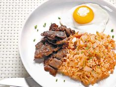 The kimchi rice's zing is a wonderful counterpoint to the richness of the meat and eggs.