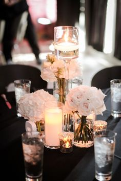 Modern White Centerpiece: Hydrangea, Lisianthis and Roses with a stemmed floating candle holder | Floral Designer: Andrea Layne Floral Design | Venue: Nova 535 | Photography: Life Long Studios