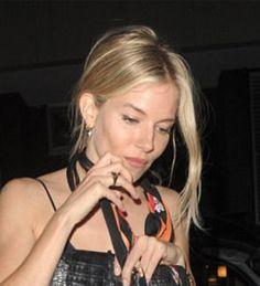 Sienna Miller wears our Sophie Lis Fallen Star diamond hoop earrings
