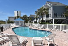 The Portofino I community, located 0.9 miles north of Garden City Pier. The featured vacation home is Conched Out. Vacation Rentals, Beach House, Community, City, Garden, Outdoor Decor, Home, Beach Homes, Garten