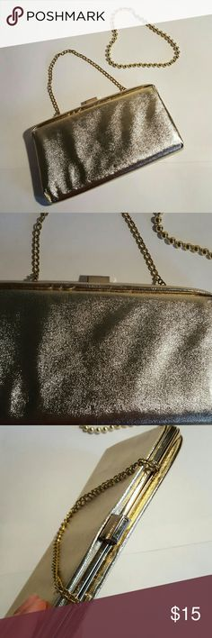 SALE BUNDLE GOLD EVENING CLUTCH AND GOLD PEARLS Condition 8/10, no scuffs or stains , Height 5.5', Length 9.5', Width 1'. It comes with the gold pearl necklace (not real pearls) if you have any questions just let me know. Thanks. Happy Holidays. no brand Bags Clutches & Wristlets