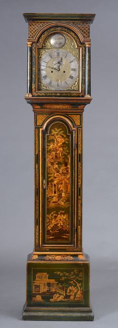 """GEORGE III BOTTLE GREEN JAPANNED TALL CASE CLOCK With a brass embossed dial, """"Tempus Fugit,"""" within a rectangular top with an arched glazed panel flanked by columns, above one paneled door, raised on molded feet, the whole painted with chinoiserie decoration"""