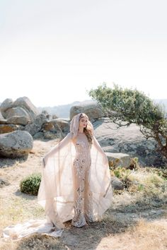 Your wanderlust wedding is about to take flight with inspiration from today's luxe Grecian elopement featuring a hooded bridal cape!