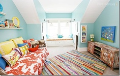 So many fun colors play well with turquoise in this playroom