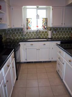 Stenciled backsplash 25 + Great Kitchen Backsplashes at Remodelaholic #kitchen #backspash_ideas