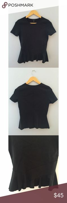 JCrew Peplum Shirt Black short sleeved JCrew peplum shirt with a seam down the back and small seam detailing on the front J. Crew Tops Blouses