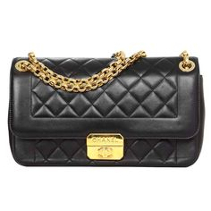 CHANEL Black Quilted Lambskin Flap Bag GHW | From a collection of rare vintage shoulder bags at https://www.1stdibs.com/fashion/handbags-purses-bags/shoulder-bags/