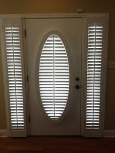 A Front Door With An Oval Window Beautiful Covered With 2 189 Quot Louverwood Plantation Shutters From The Louver Shop The I Window Treatments For